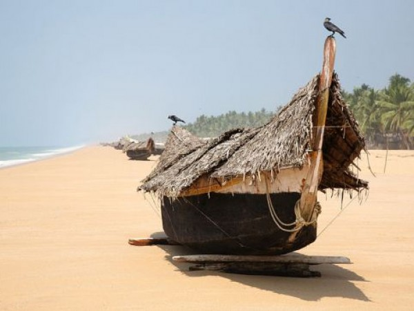 Poovar photos, Poovar Beach - A Boat on The Coast