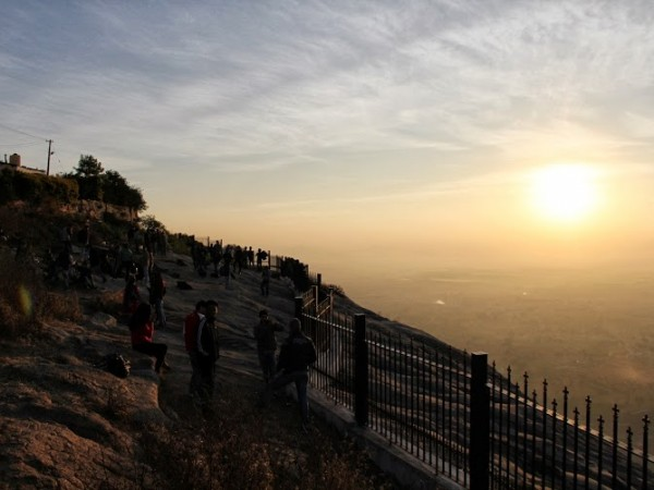 Nandi Hills photos, Visitors retarding after the bewitching sunrise at Nandi Hills