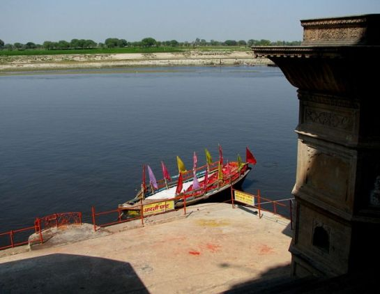 Vrindavan photos, Yamuna River - A boat with colourful flags