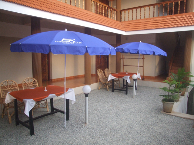 Dining under umbrella