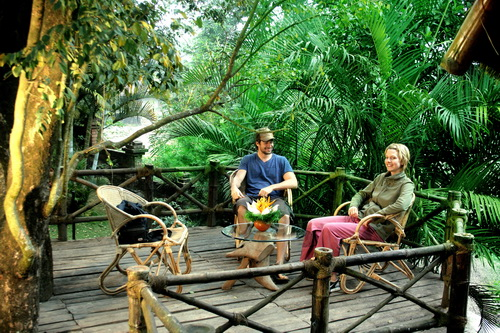 Guests relaxing in sit-out at the Bamboo Tree House