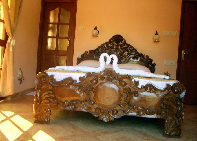 Carved bed